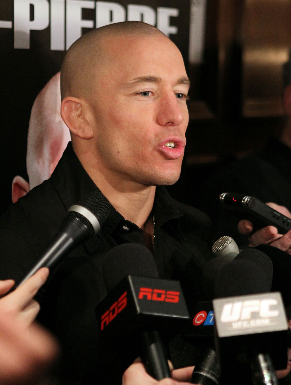UFC Welterweight Champion Georges St-Pierre answers questions from the media at the UFC 124 open workouts at the Marriott Chateau Champlain in on December 8, 2010 in Montreal, Quebec, Canada.