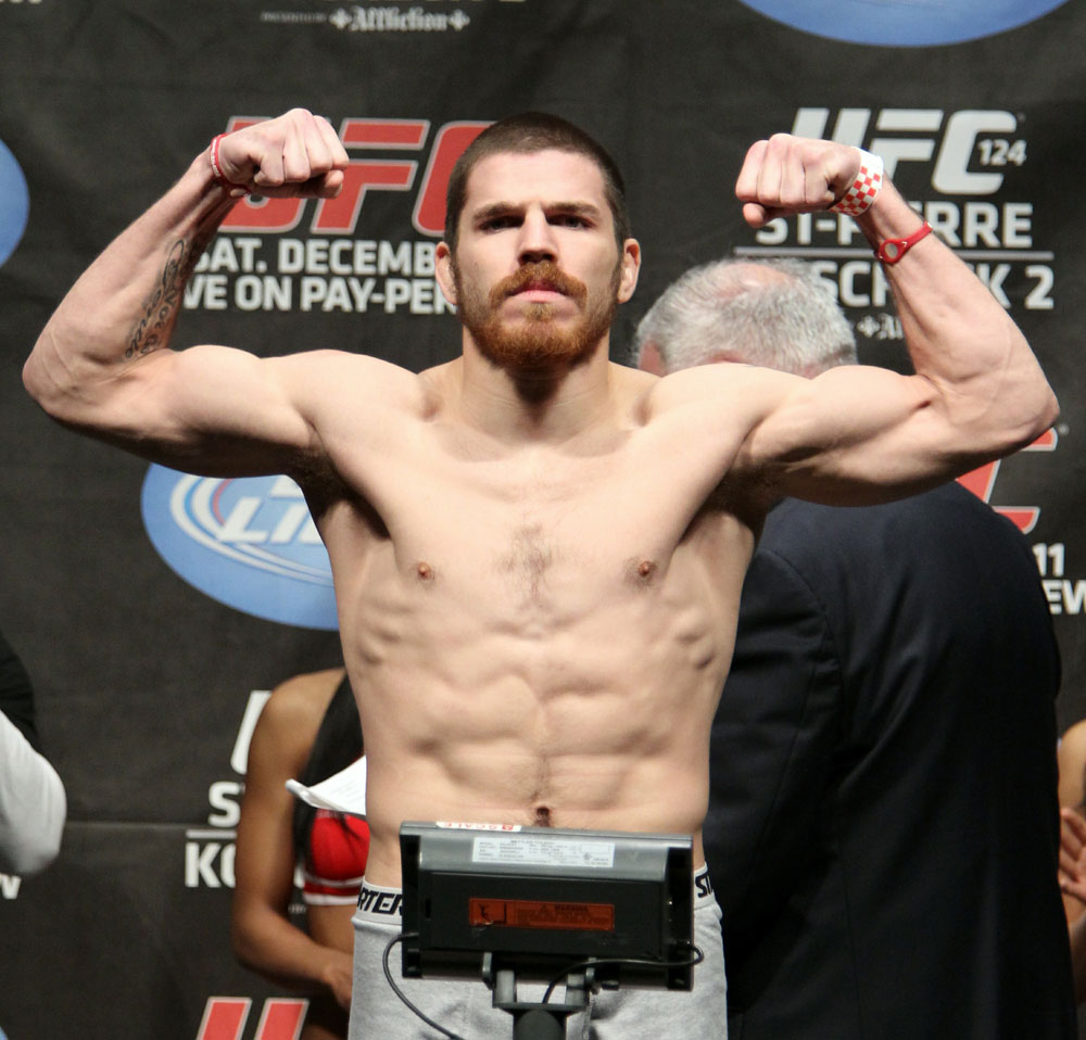 UFC 124 Weigh-in: Jim Miller weighs in at 155lb.