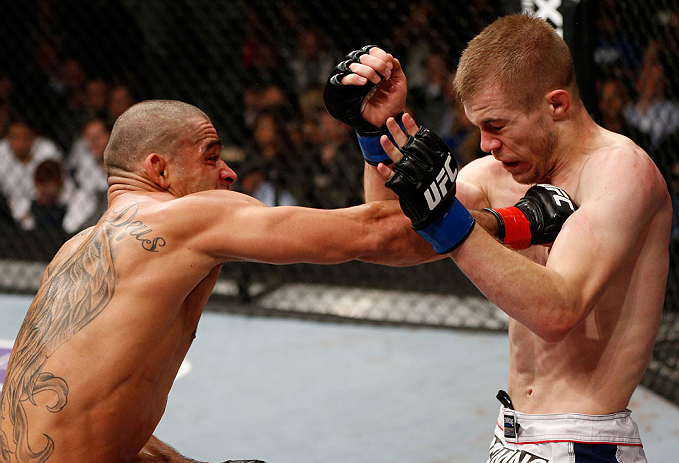 LONDON, ENGLAND - FEBRUARY 16:  (L-R) Renan Barao punches Michael McDonald in their interim bantamweight title fight during the UFC on Fuel TV event on February 16, 2013 at Wembley Arena in London, England.  (Photo by Josh Hedges/Zuffa LLC/Zuffa LLC via Getty Images)