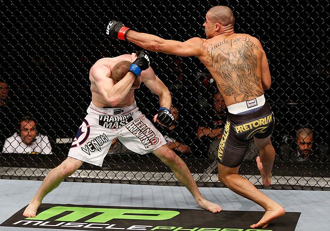LONDON, ENGLAND - FEBRUARY 16:  (R-L) Renan Barao punches Michael McDonald in their interim bantamweight title fight during the UFC on Fuel TV event on February 16, 2013 at Wembley Arena in London, England.  (Photo by Josh Hedges/Zuffa LLC/Zuffa LLC via Getty Images)