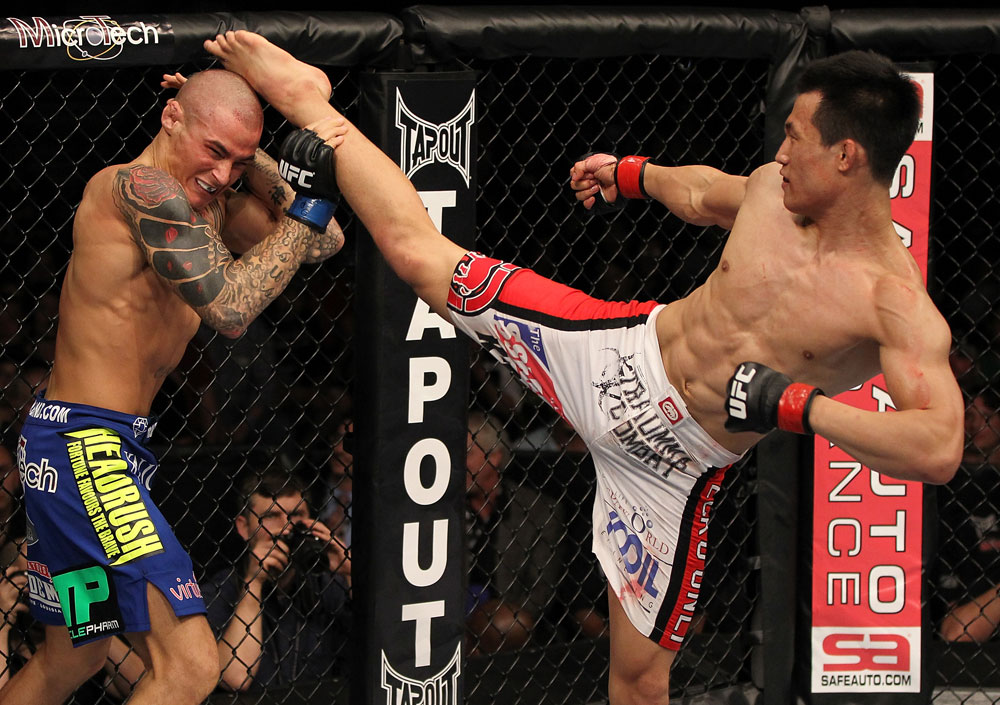 "FAIRFAX, VA - MAY 15:  (R-L) ""The Korean Zombie"" Chan Sung Jung kicks Dustin Poirier in a featherweight bout during the UFC on Fuel TV event at Patriot Center on May 15, 2012 in Fairfax, Virginia.  (Photo by Josh Hedges/Zuffa LLC/Zuffa LLC via Getty Images)"