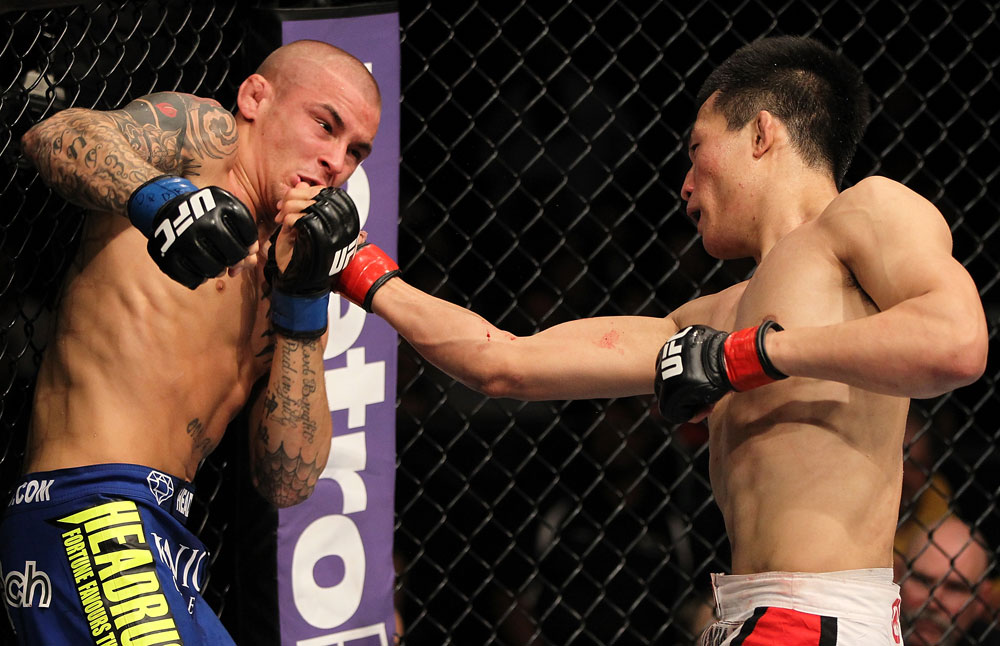 "FAIRFAX, VA - MAY 15:  (R-L) ""The Korean Zombie"" Chan Sung Jung punches Dustin Poirier in a featherweight bout during the UFC on Fuel TV event at Patriot Center on May 15, 2012 in Fairfax, Virginia.  (Photo by Josh Hedges/Zuffa LLC/Zuffa LLC via Getty Images)"