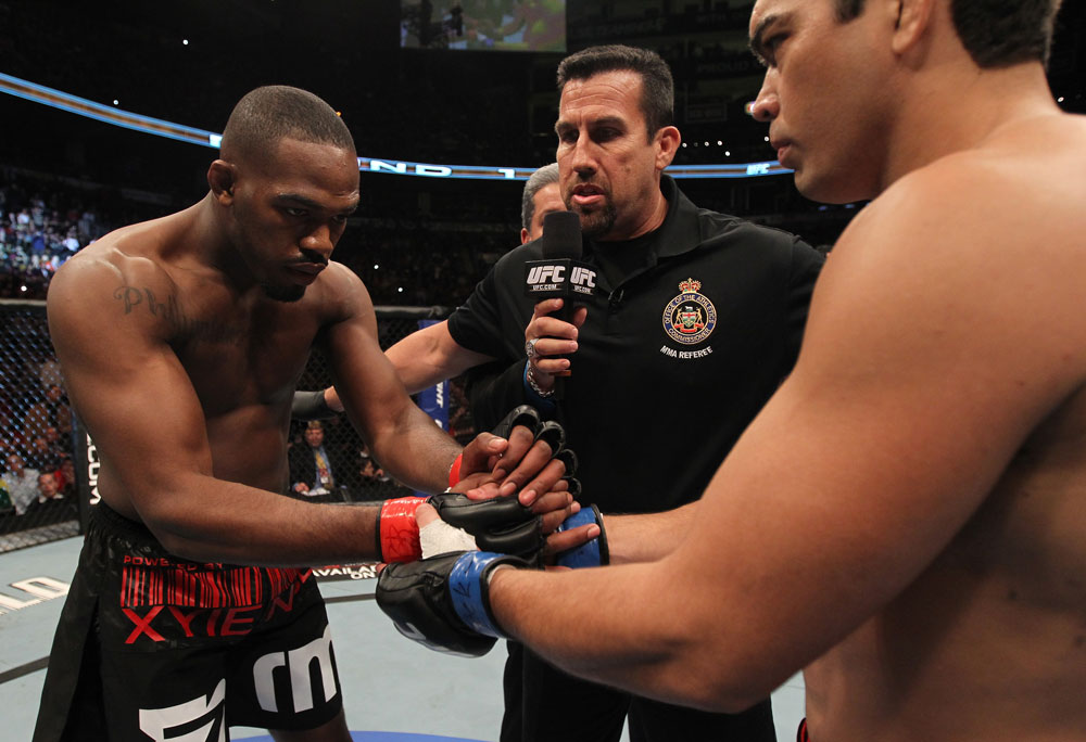 TORONTO, ON - DECEMBER 10:  (L-R) Light Heavyweight Champion Jon Jones and challenger Lyoto Machida receive final instructions from referee John McCarthy before their bout. (Photo by Nick Laham/Zuffa LLC/Zuffa LLC via Getty Images)