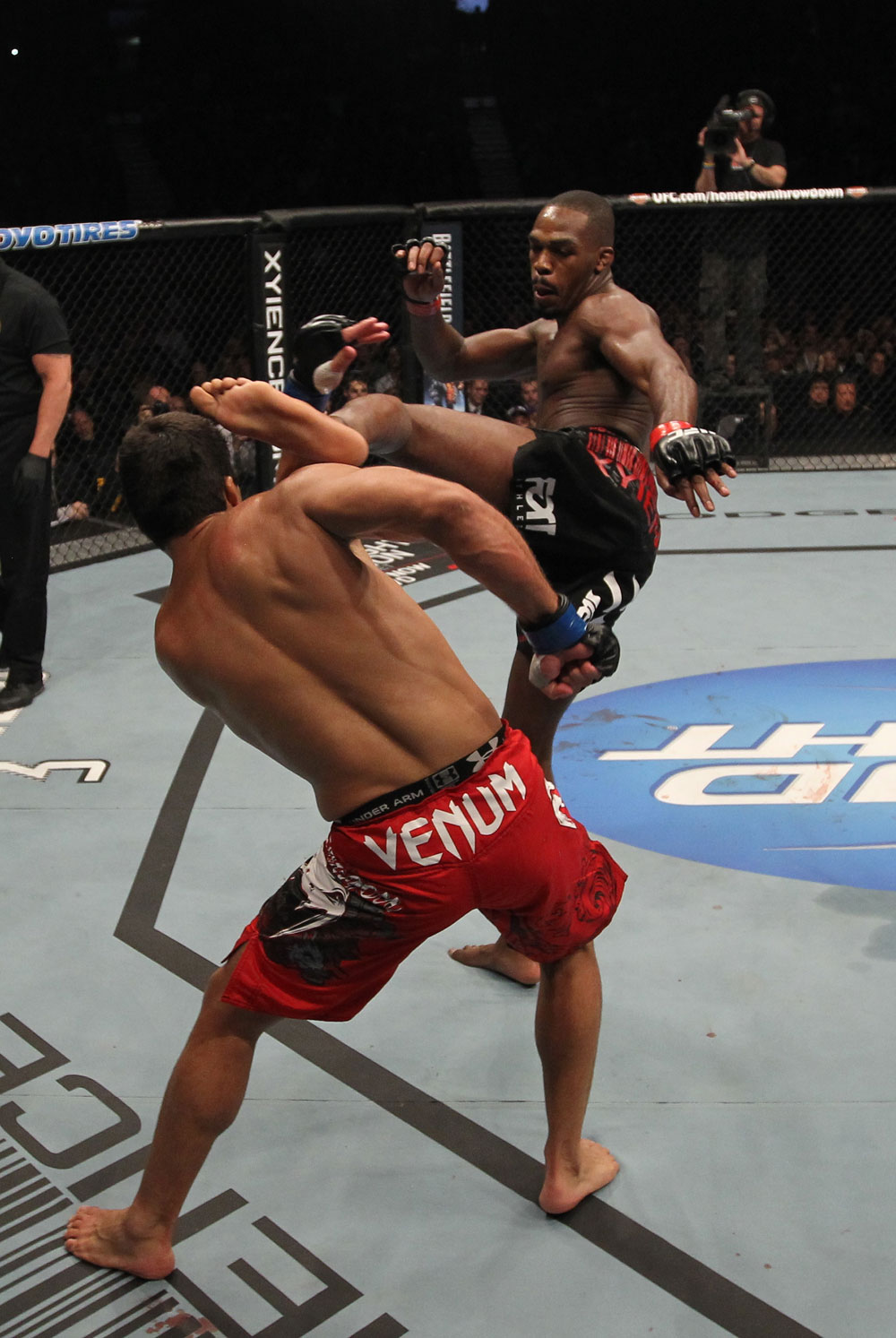 TORONTO, ON - DECEMBER 10:  (R-L) Jon &quot;Bones&quot; Jones kicks Lyoto Machida during the UFC 140 event at Air Canada Centre on December 10, 2011 in Toronto, Ontario, Canada.  (Photo by Nick Laham/Zuffa LLC/Zuffa LLC via Getty Images)