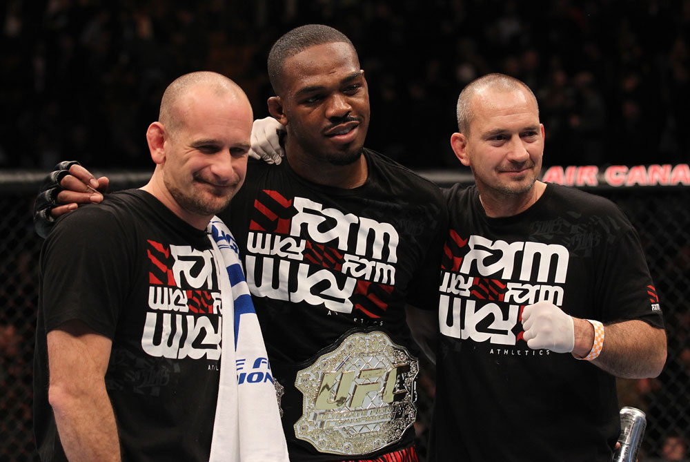 "TORONTO, ON - DECEMBER 10:  UFC Light Heavyweight Champion Jon ""Bones"" Jones poses for a photo with his trainers Greg Jackson (L) and Mike Winklejohn (R) after defeating Lyoto Machida during the UFC 140 event at Air Canada Centre on December 10, 2011 in Toronto, Ontario, Canada.  (Photo by Nick Laham/Zuffa LLC/Zuffa LLC via Getty Images)"