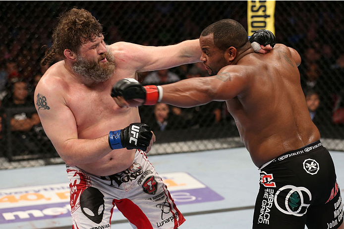 HOUSTON, TEXAS - OCTOBER 19:  (R-L) Daniel Cormier punches Roy 'Big Country' Nelson in their UFC heavyweight bout at the Toyota Center on October 19, 2013 in Houston, Texas. (Photo by Nick Laham/Zuffa LLC/Zuffa LLC via Getty Images)