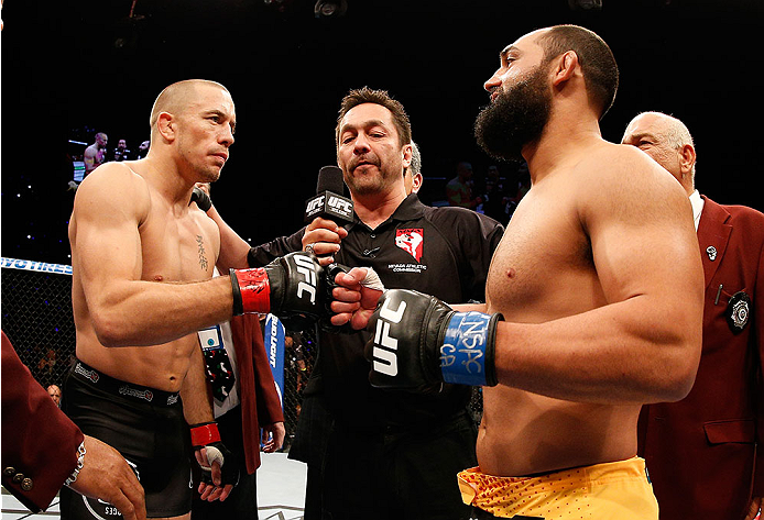 LAS VEGAS, NV - NOVEMBER 16:  (L-R) Georges St-Pierre and Johny Hendricks touch gloves before their UFC welterweight championship bout during the UFC 167 event inside the MGM Grand Garden Arena on November 16, 2013 in Las Vegas, Nevada. (Photo by Josh Hedges/Zuffa LLC/Zuffa LLC via Getty Images) *** Local Caption *** Georges St-Pierre; Johny Hendricks