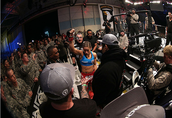 FORT CAMPBELL, KENTUCKY - NOVEMBER 6:  Liz Carmouche (center) prepares to enter the Octagon to face Alexis Davis in their UFC women's bantamweight bout on November 6, 2013 in Fort Campbell, Kentucky. (Photo by Ed Mulholland/Zuffa LLC/Zuffa LLC via Getty Images) *** Local Caption ***Liz Carmouche