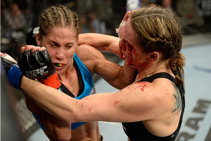 FORT CAMPBELL, KENTUCKY - NOVEMBER 6:  (R-L) Alexis Davis punches Liz Carmouche in their UFC women's bantamweight bout on November 6, 2013 in Fort Campbell, Kentucky. (Photo by Jeff Bottari/Zuffa LLC/Zuffa LLC via Getty Images) *** Local Caption ***Liz Carmouche; Alexis Davis