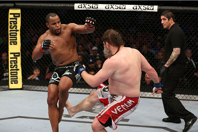 HOUSTON, TEXAS - OCTOBER 19:  (R-L) Roy 'Big Country' Nelson kicks Daniel Cormier in their UFC heavyweight bout at the Toyota Center on October 19, 2013 in Houston, Texas. (Photo by Nick Laham/Zuffa LLC/Zuffa LLC via Getty Images)