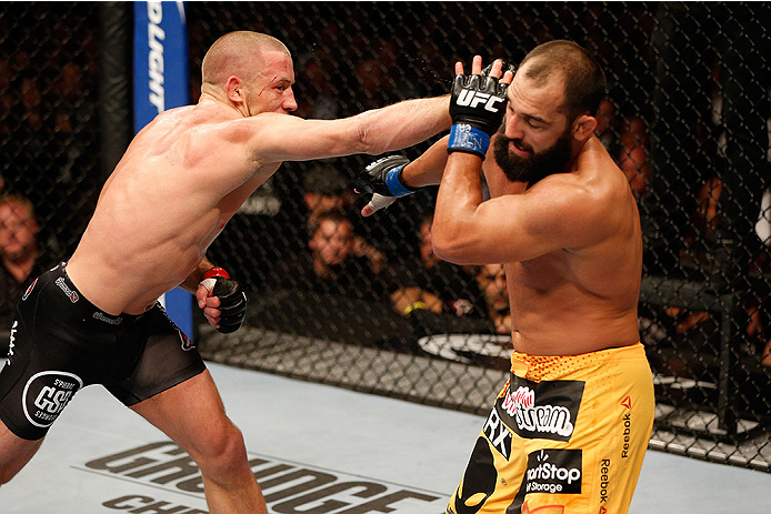 LAS VEGAS, NV - NOVEMBER 16:  (L-R) Georges St-Pierre punches Johny Hendricks in their UFC welterweight championship bout during the UFC 167 event inside the MGM Grand Garden Arena on November 16, 2013 in Las Vegas, Nevada. (Photo by Josh Hedges/Zuffa LLC/Zuffa LLC via Getty Images) *** Local Caption *** Georges St-Pierre; Johny Hendricks