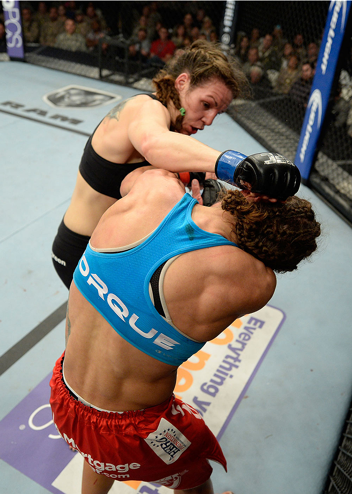 FORT CAMPBELL, KENTUCKY - NOVEMBER 6:  Alexis Davis (top) punches Liz Carmouche in their UFC women's bantamweight bout on November 6, 2013 in Fort Campbell, Kentucky. (Photo by Jeff Bottari/Zuffa LLC/Zuffa LLC via Getty Images) *** Local Caption ***Liz Carmouche; Alexis Davis