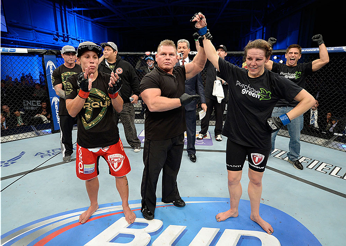 FORT CAMPBELL, KENTUCKY - NOVEMBER 6:  Alexis Davis (right) is declared the winner over Liz Carmouche (left) in their UFC women's bantamweight bout on November 6, 2013 in Fort Campbell, Kentucky. (Photo by Jeff Bottari/Zuffa LLC/Zuffa LLC via Getty Images) *** Local Caption ***Liz Carmouche; Alexis Davis