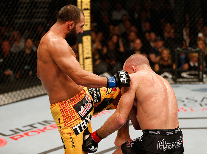 LAS VEGAS, NV - NOVEMBER 16:  Johny Hendricks (left) knees Georges St-Pierre in their UFC welterweight championship bout during the UFC 167 event inside the MGM Grand Garden Arena on November 16, 2013 in Las Vegas, Nevada. (Photo by Josh Hedges/Zuffa LLC/Zuffa LLC via Getty Images) *** Local Caption *** Georges St-Pierre; Johny Hendricks