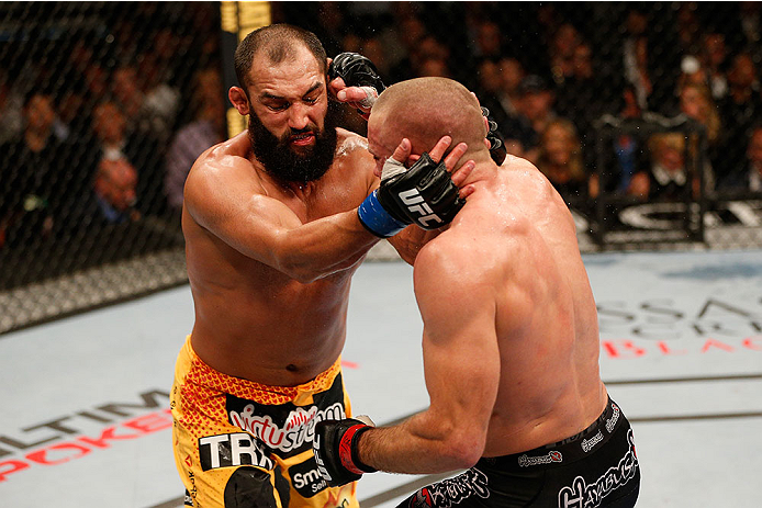 LAS VEGAS, NV - NOVEMBER 16:  Georges St-Pierre (right) punches Johny Hendricks in their UFC welterweight championship bout during the UFC 167 event inside the MGM Grand Garden Arena on November 16, 2013 in Las Vegas, Nevada. (Photo by Josh Hedges/Zuffa LLC/Zuffa LLC via Getty Images) *** Local Caption *** Georges St-Pierre; Johny Hendricks
