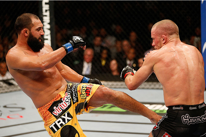LAS VEGAS, NV - NOVEMBER 16:  Johny Hendricks (left) kicks Georges St-Pierre in their UFC welterweight championship bout during the UFC 167 event inside the MGM Grand Garden Arena on November 16, 2013 in Las Vegas, Nevada. (Photo by Josh Hedges/Zuffa LLC/Zuffa LLC via Getty Images) *** Local Caption *** Georges St-Pierre; Johny Hendricks
