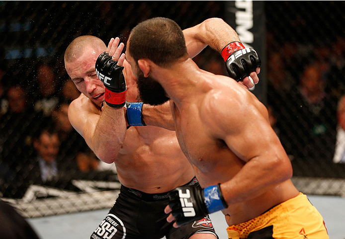 LAS VEGAS, NV - NOVEMBER 16:  Johny Hendricks (right) punches Georges St-Pierre in their UFC welterweight championship bout during the UFC 167 event inside the MGM Grand Garden Arena on November 16, 2013 in Las Vegas, Nevada. (Photo by Josh Hedges/Zuffa LLC/Zuffa LLC via Getty Images) *** Local Caption *** Georges St-Pierre; Johny Hendricks