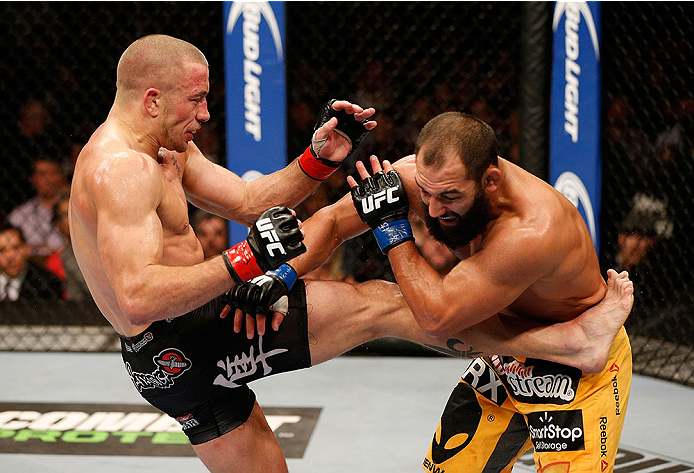 LAS VEGAS, NV - NOVEMBER 16:  (L-R) Georges St-Pierre kicks Johny Hendricks in their UFC welterweight championship bout during the UFC 167 event inside the MGM Grand Garden Arena on November 16, 2013 in Las Vegas, Nevada. (Photo by Josh Hedges/Zuffa LLC/Zuffa LLC via Getty Images) *** Local Caption *** Georges St-Pierre; Johny Hendricks