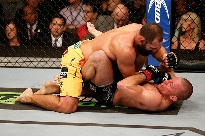 LAS VEGAS, NV - NOVEMBER 16:  Johny Hendricks (top) punches Georges St-Pierre in their UFC welterweight championship bout during the UFC 167 event inside the MGM Grand Garden Arena on November 16, 2013 in Las Vegas, Nevada. (Photo by Josh Hedges/Zuffa LLC/Zuffa LLC via Getty Images) *** Local Caption *** Georges St-Pierre; Johny Hendricks