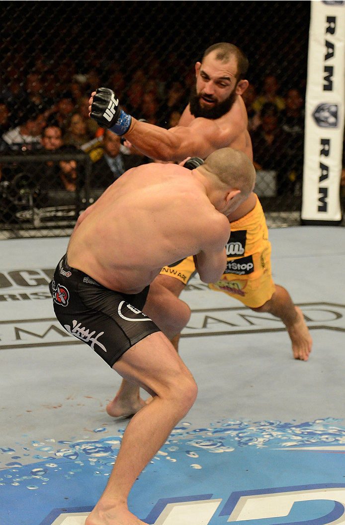 LAS VEGAS, NV - NOVEMBER 16:  Johny Hendricks (top) punches Georges St-Pierre in their UFC welterweight championship bout during the UFC 167 event inside the MGM Grand Garden Arena on November 16, 2013 in Las Vegas, Nevada. (Photo by Donald Miralle/Zuffa LLC/Zuffa LLC via Getty Images) *** Local Caption *** Georges St-Pierre; Johny Hendricks