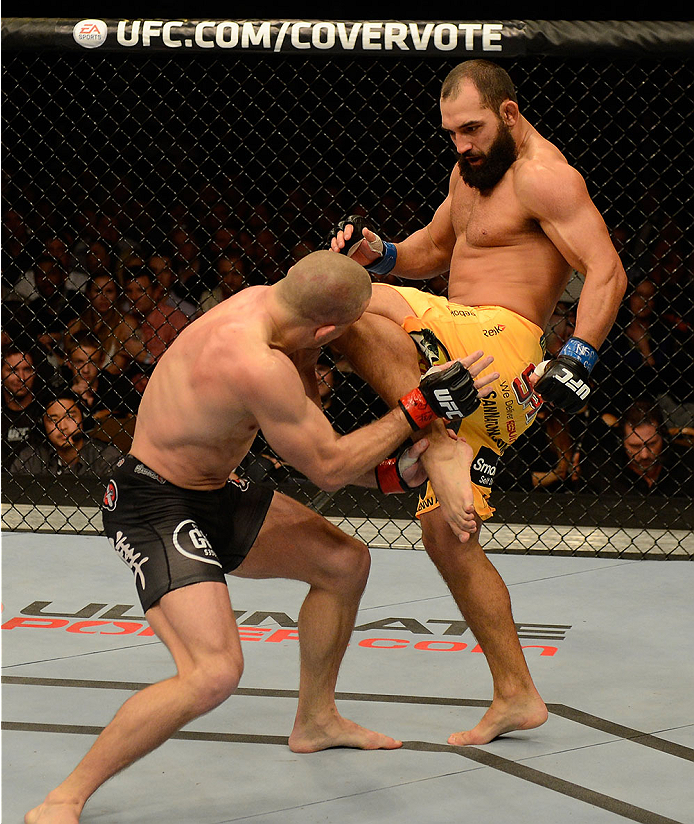 LAS VEGAS, NV - NOVEMBER 16:  (R-L) Johny Hendricks knees Georges St-Pierre in their UFC welterweight championship bout during the UFC 167 event inside the MGM Grand Garden Arena on November 16, 2013 in Las Vegas, Nevada. (Photo by Donald Miralle/Zuffa LLC/Zuffa LLC via Getty Images) *** Local Caption *** Georges St-Pierre; Johny Hendricks