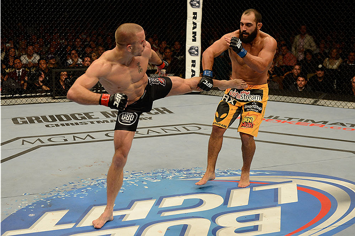 LAS VEGAS, NV - NOVEMBER 16:  (L-R) Georges St-Pierre kicks Johny Hendricks in their UFC welterweight championship bout during the UFC 167 event inside the MGM Grand Garden Arena on November 16, 2013 in Las Vegas, Nevada. (Photo by Donald Miralle/Zuffa LLC/Zuffa LLC via Getty Images) *** Local Caption *** Georges St-Pierre; Johny Hendricks
