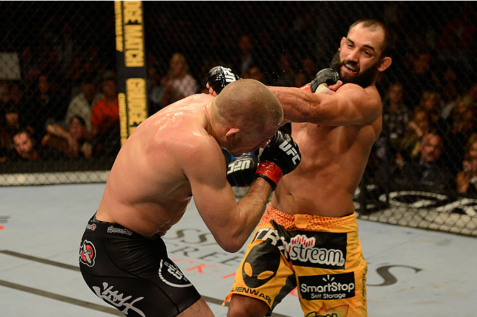 LAS VEGAS, NV - NOVEMBER 16:  (L-R) Georges St-Pierre punches Johny Hendricks in their UFC welterweight championship bout during the UFC 167 event inside the MGM Grand Garden Arena on November 16, 2013 in Las Vegas, Nevada. (Photo by Donald Miralle/Zuffa LLC/Zuffa LLC via Getty Images) *** Local Caption *** Georges St-Pierre; Johny Hendricks
