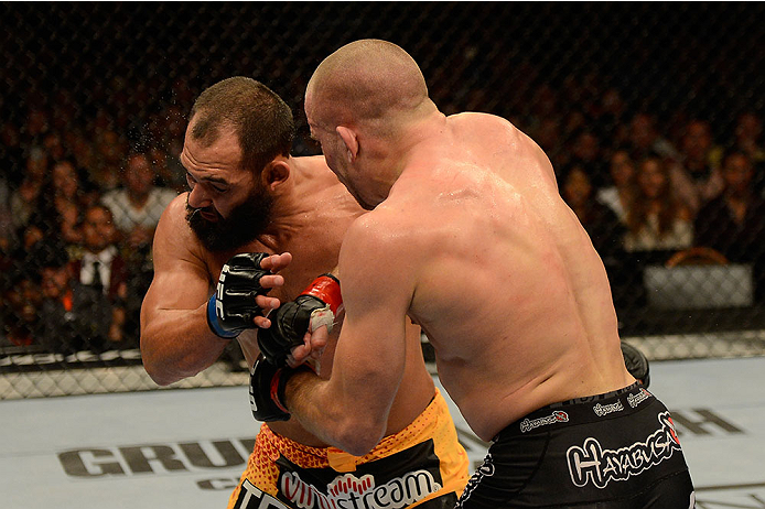 LAS VEGAS, NV - NOVEMBER 16:  (R-L) Georges St-Pierre punches Johny Hendricks in their UFC welterweight championship bout during the UFC 167 event inside the MGM Grand Garden Arena on November 16, 2013 in Las Vegas, Nevada. (Photo by Donald Miralle/Zuffa LLC/Zuffa LLC via Getty Images) *** Local Caption *** Georges St-Pierre; Johny Hendricks