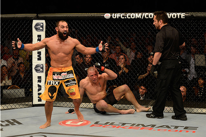 LAS VEGAS, NV - NOVEMBER 16:  Johny Hendricks (left) reacts after the end of his fight with Georges St-Pierre in their UFC welterweight championship bout during the UFC 167 event inside the MGM Grand Garden Arena on November 16, 2013 in Las Vegas, Nevada. (Photo by Donald Miralle/Zuffa LLC/Zuffa LLC via Getty Images) *** Local Caption *** Georges St-Pierre; Johny Hendricks