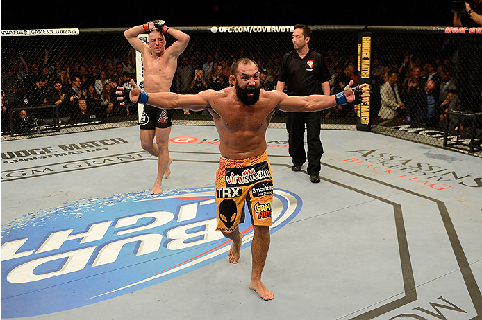 LAS VEGAS, NV - NOVEMBER 16:  Johny Hendricks (front) reacts after the end of his fight with Georges St-Pierre (rear) in their UFC welterweight championship bout during the UFC 167 event inside the MGM Grand Garden Arena on November 16, 2013 in Las Vegas, Nevada. (Photo by Donald Miralle/Zuffa LLC/Zuffa LLC via Getty Images) *** Local Caption *** Georges St-Pierre; Johny Hendricks