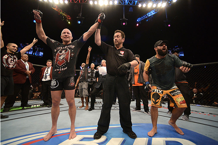 LAS VEGAS, NV - NOVEMBER 16:  Georges St-Pierre (left) is declared the winner over Johny Hendricks (right) in their UFC welterweight championship bout during the UFC 167 event inside the MGM Grand Garden Arena on November 16, 2013 in Las Vegas, Nevada. (Photo by Donald Miralle/Zuffa LLC/Zuffa LLC via Getty Images) *** Local Caption *** Georges St-Pierre; Johny Hendricks