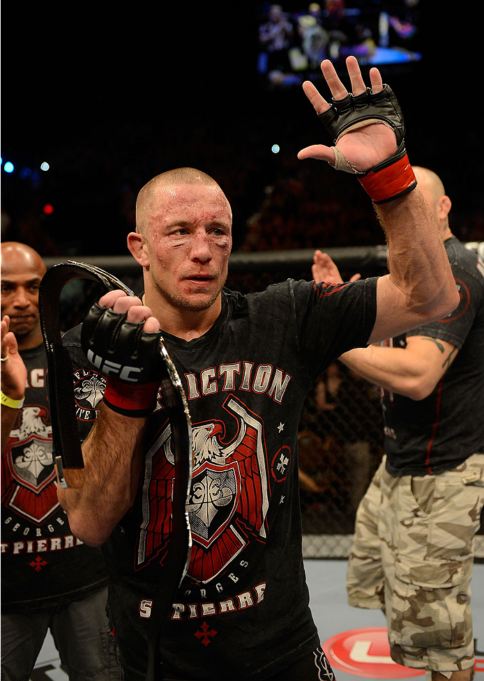 LAS VEGAS, NV - NOVEMBER 16:  Georges St-Pierre reacts to his victory over Johny Hendricks in their UFC welterweight championship bout during the UFC 167 event inside the MGM Grand Garden Arena on November 16, 2013 in Las Vegas, Nevada. (Photo by Donald Miralle/Zuffa LLC/Zuffa LLC via Getty Images) *** Local Caption *** Georges St-Pierre