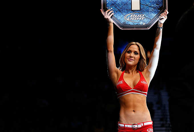 LAS VEGAS, NV - MAY 25:   UFC Octagon Girl Brittney Palmer introduces round one of Bermudez vs Holloway in their featherweight bout during UFC 160 at the MGM Grand Garden Arena on May 25, 2013 in Las Vegas, Nevada.  (Photo by Josh Hedges/Zuffa LLC/Zuffa LLC via Getty Images)  *** Local Caption *** Dennis Bermudez; Max Holloway