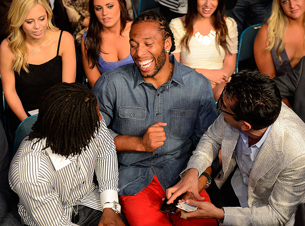 LAS VEGAS, NV - MAY 25:   Professional football player Larry Fitzgerald of the Arizona Cardinals (center) and professional poker player Antonio Esfandiari (right) in attendance during UFC 160 at the MGM Grand Garden Arena on May 25, 2013 in Las Vegas, Nevada.  (Photo by Donald Miralle/Zuffa LLC/Zuffa LLC via Getty Images)  *** Local Caption *** Larry Fitzgerald; Antonio Esfandiari