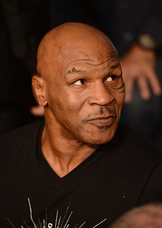 LAS VEGAS, NV - MAY 25:   Former professional boxer Mike Tyson in attendance during UFC 160 at the MGM Grand Garden Arena on May 25, 2013 in Las Vegas, Nevada.  (Photo by Donald Miralle/Zuffa LLC/Zuffa LLC via Getty Images)  *** Local Caption *** Mike Tyson