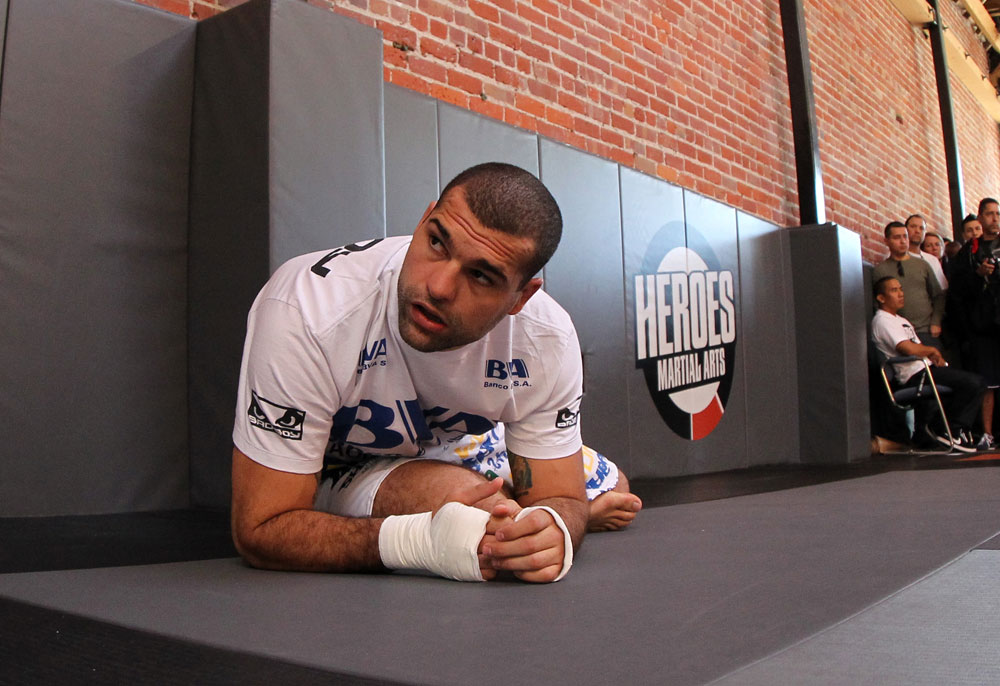"SAN JOSE, CA - NOVEMBER 16:  Mauricio ""Shogun"" Rua stretches before working out for the fans and media during the UFC 139 open workouts at the Heroes Martial Arts Gym on November 16, 2011 in San Jose, California.  (Photo by Josh Hedges/Zuffa LLC/Zuffa LLC via Getty Images)"