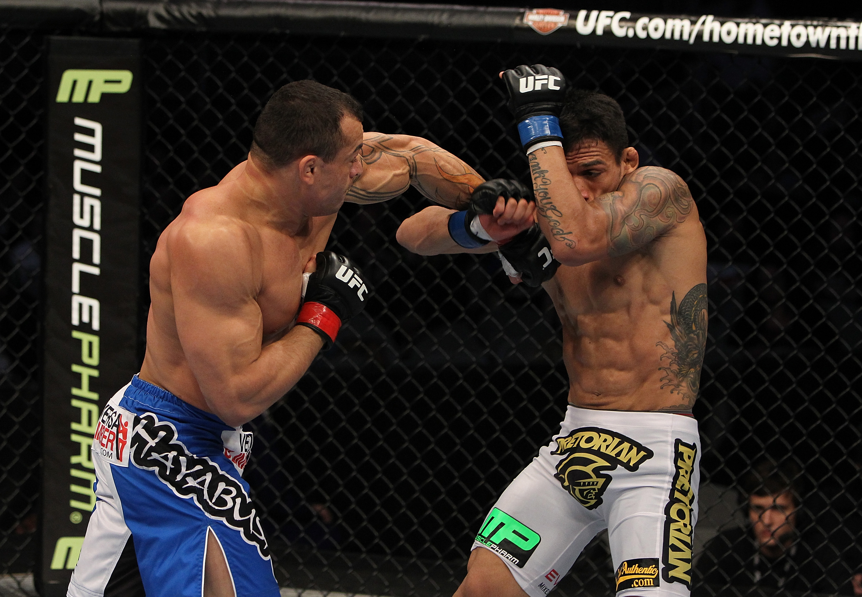 SAN JOSE, CA - NOVEMBER 19: (L-R) Gleison Tibau punches Rafael dos Anjos during an UFC Lightweight bout at the HP Pavillion in San Jose, California on November 19, 2011 in San Jose, California.  (Photo by Josh Hedges/Zuffa LLC/Zuffa LLC via Getty Images)