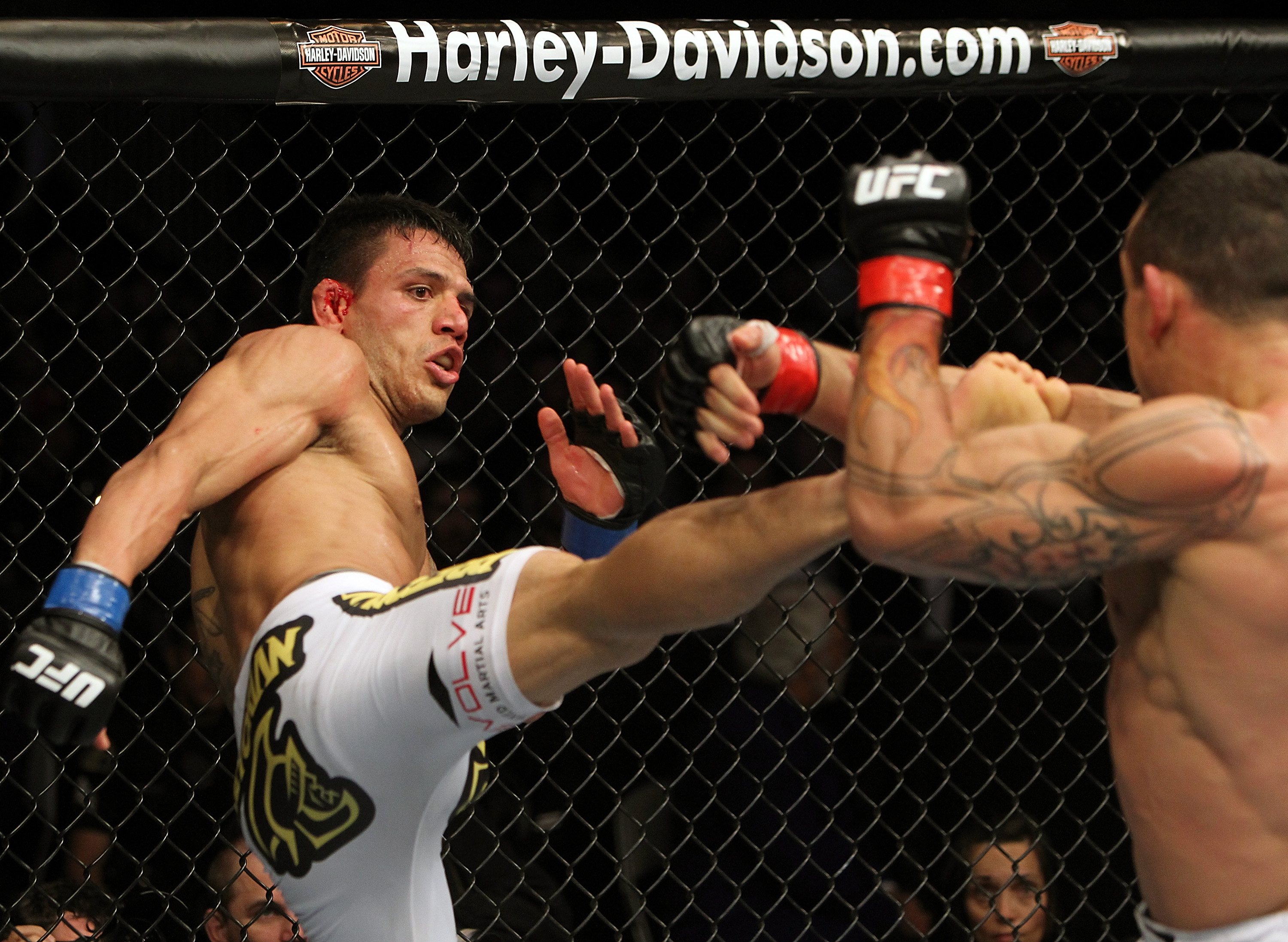 SAN JOSE, CA - NOVEMBER 19: (L-R) Rafael dos Anjos kicks Gleison Tibau during an UFC Lightweight bout at the HP Pavillion in San Jose, California on November 19, 2011 in San Jose, California.  (Photo by Josh Hedges/Zuffa LLC/Zuffa LLC via Getty Images)