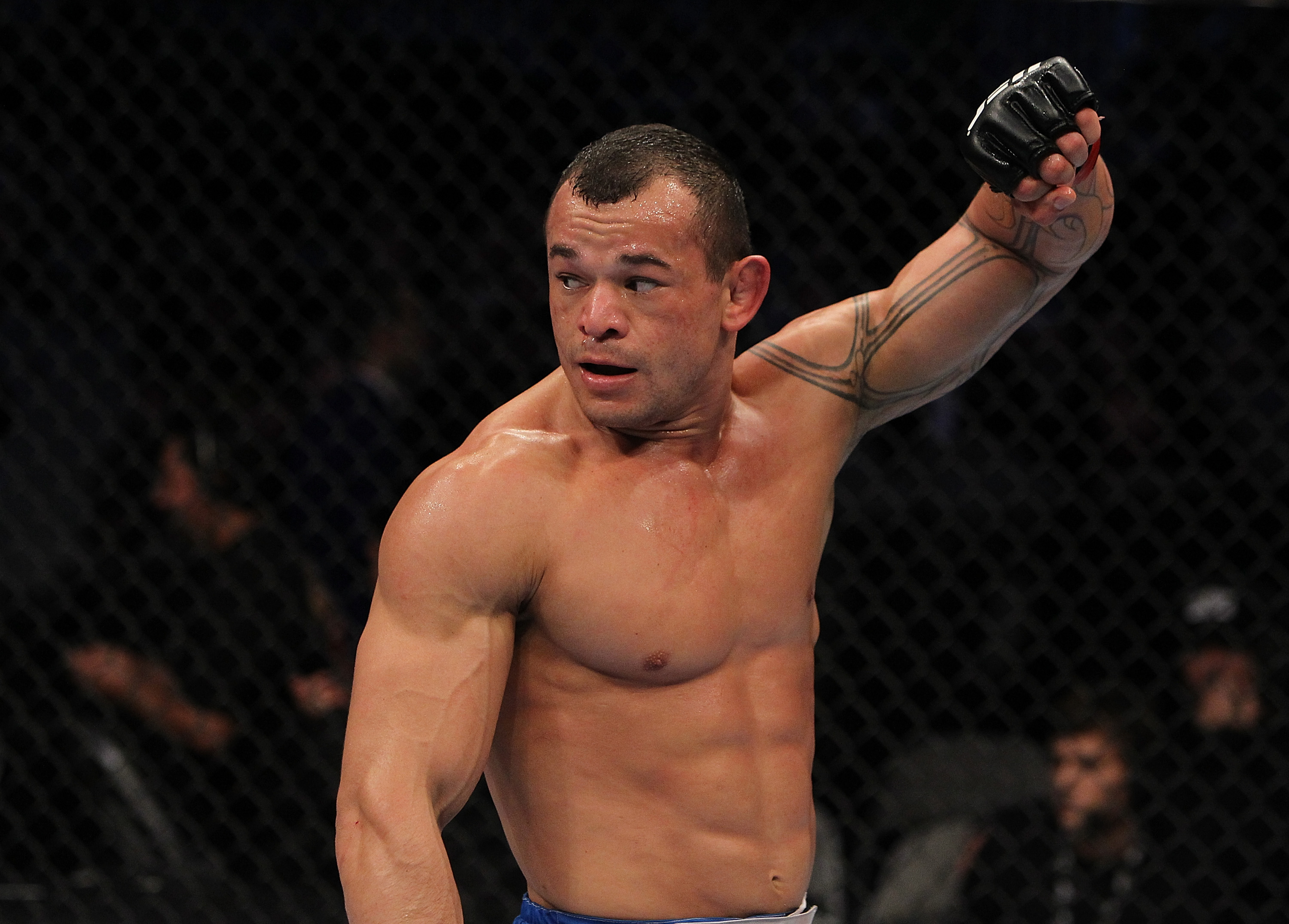 SAN JOSE, CA - NOVEMBER 19: Gleison Tibau celebrates defeating Rafael dos Anjos during an UFC Lightweight bout at the HP Pavilion in San Jose, California on November 19, 2011 in San Jose, California.  (Photo by Josh Hedges/Zuffa LLC/Zuffa LLC via Getty Images)