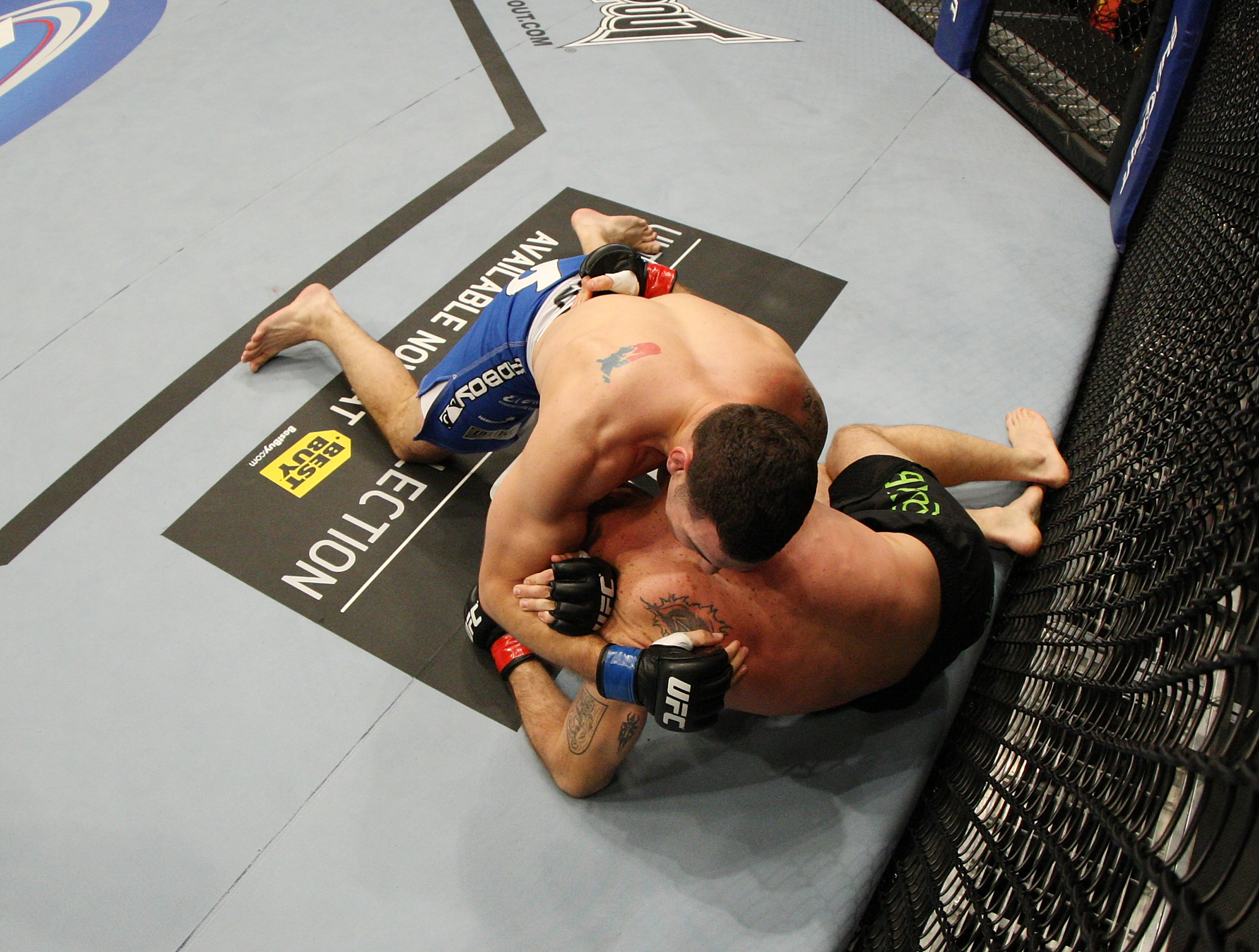 SAN JOSE, CA - NOVEMBER 19: Chris Weidman with a choke hold takes Tom Lawlor to the mat during an UFC Middleweight bout at the HP Pavillion on November 19, 2011 in San Jose, California.  (Photo by Josh Hedges/Zuffa LLC/Zuffa LLC via Getty Images)