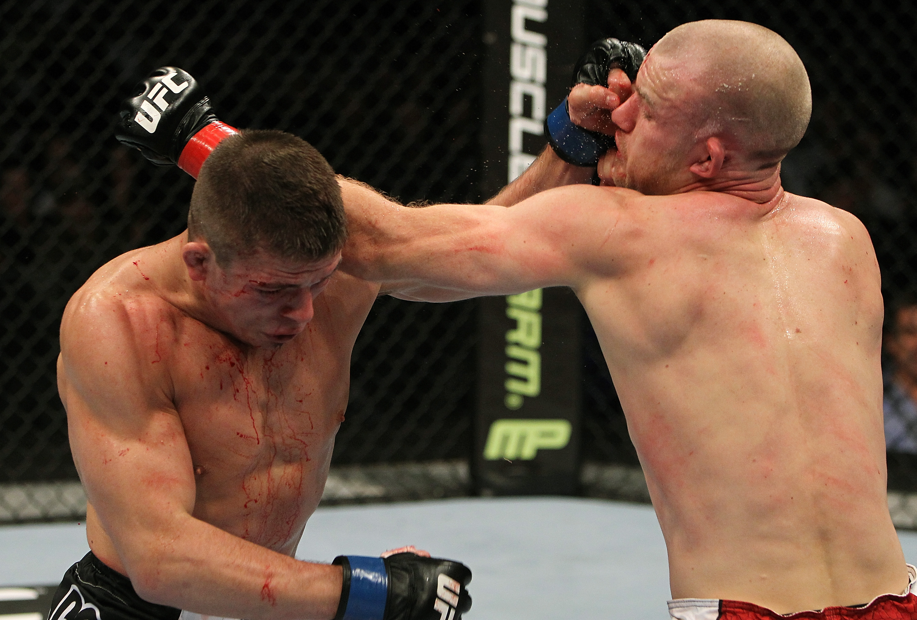 SAN JOSE, CA - NOVEMBER 19:  (R-L) Martin Kampmann and Rick Story exchange punches during an UFC Welterweight bout at the HP Pavillion on November 19, 2011 in San Jose, California.  (Photo by Josh Hedges/Zuffa LLC/Zuffa LLC via Getty Images)