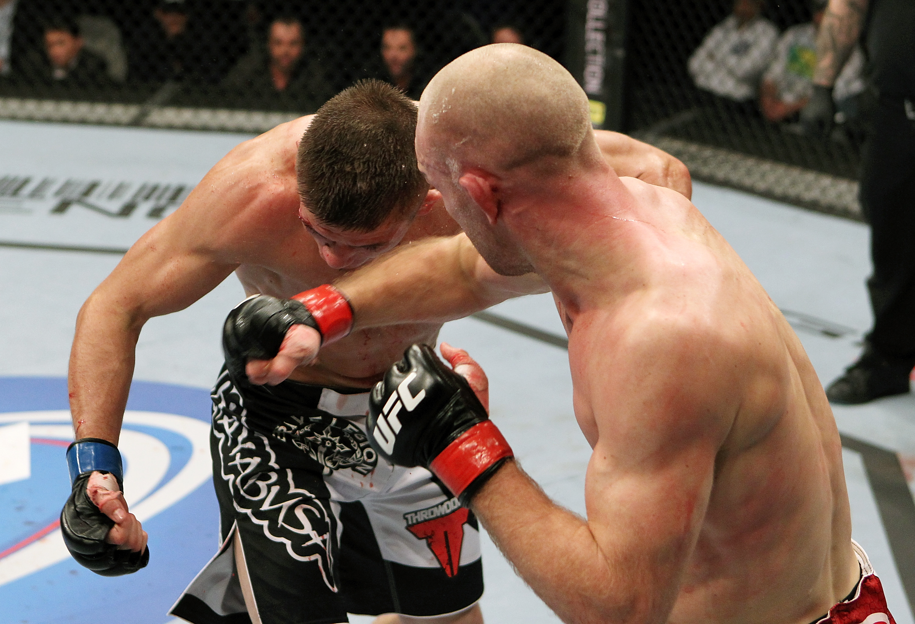 SAN JOSE, CA - NOVEMBER 19:  (R-L) Martin Kampmann punches Rick Story during an UFC Welterweight bout at the HP Pavillion on November 19, 2011 in San Jose, California.  (Photo by Josh Hedges/Zuffa LLC/Zuffa LLC via Getty Images)