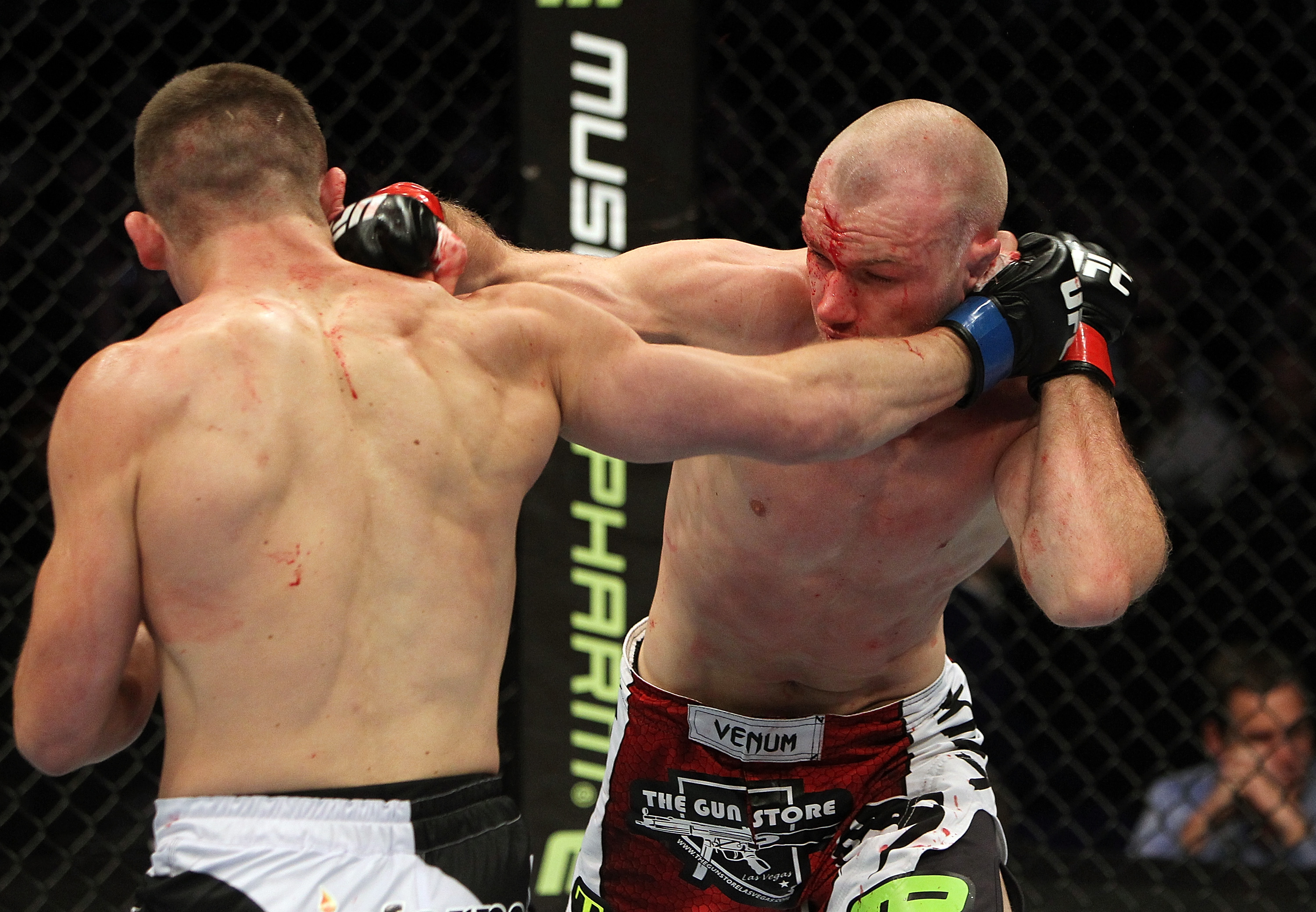SAN JOSE, CA - NOVEMBER 19: Rick Story and Martin Kampmann exchange punches during an UFC Light Heavywieght bout at the HP Pavilion on November 19, 2011 in San Jose, California.  (Photo by Josh Hedges/Zuffa LLC/Zuffa LLC via Getty Images)