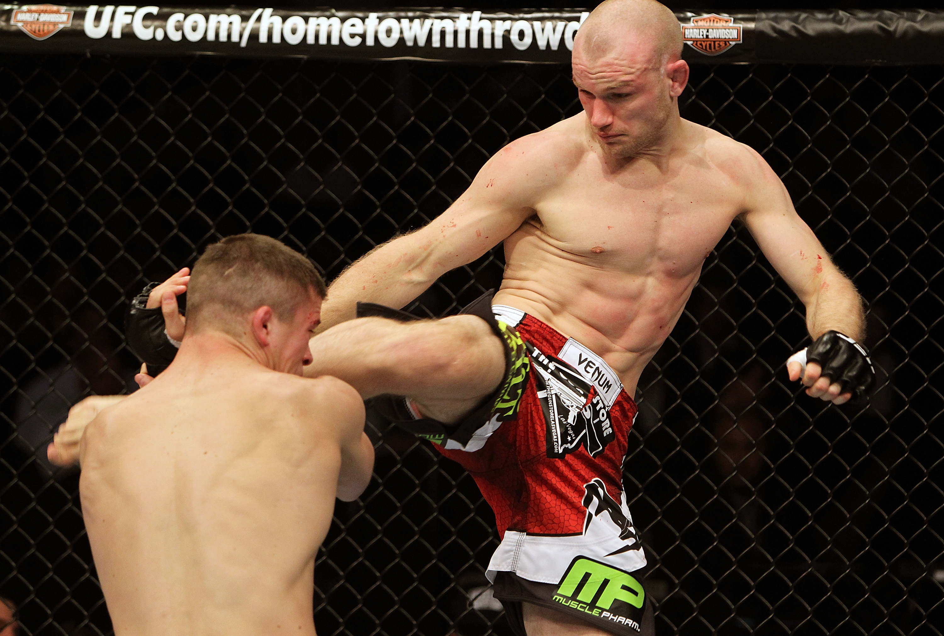 SAN JOSE, CA - NOVEMBER 19:  (R-L) Martin Kampmann kicks Rick Story during an UFC Welterweight bout at the HP Pavillion on November 19, 2011 in San Jose, California.  (Photo by Josh Hedges/Zuffa LLC/Zuffa LLC via Getty Images)