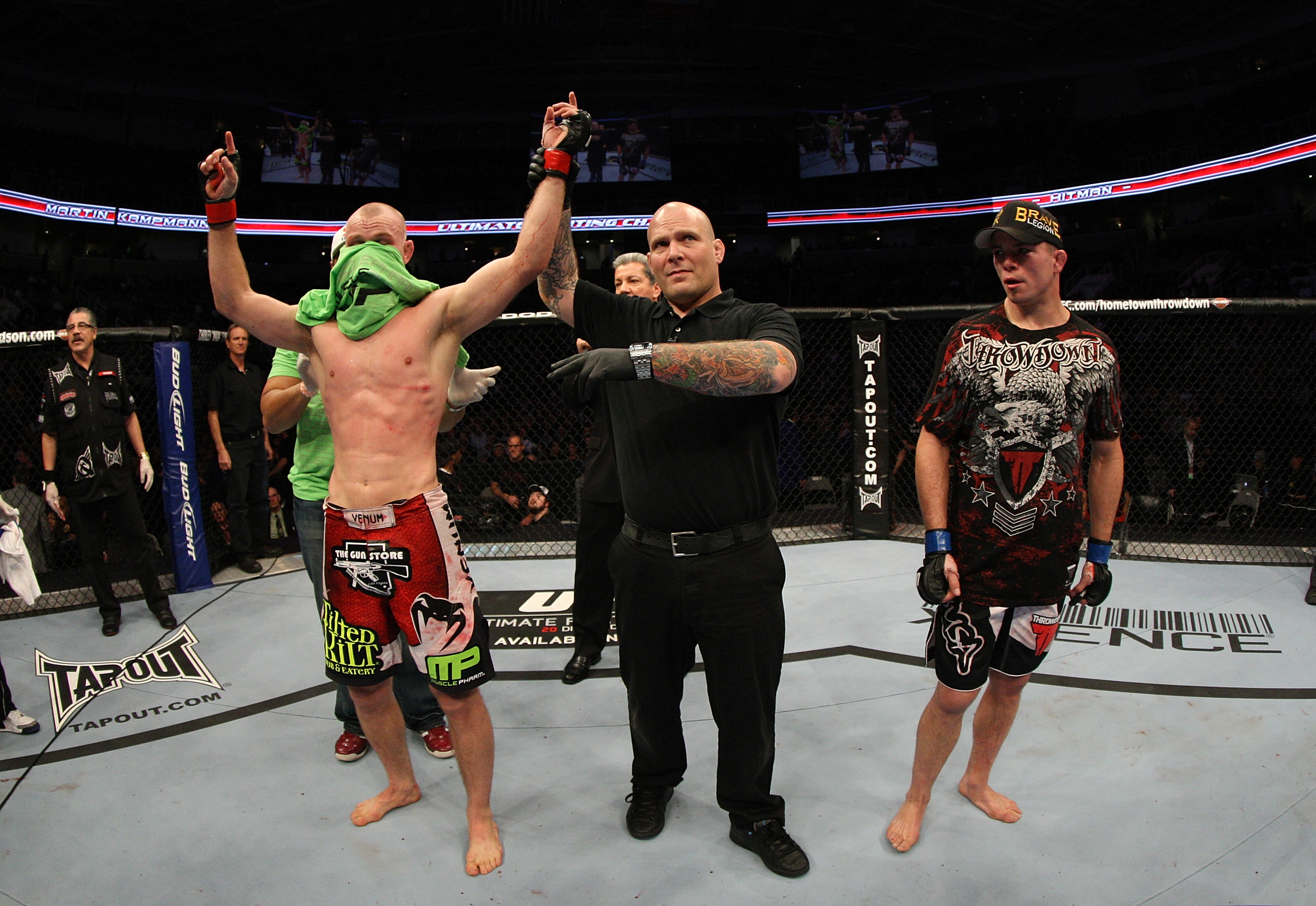 SAN JOSE, CA - NOVEMBER 19: (L-R) Martin Kampmann celebrates defeating Rick Story during an UFC Welterweight bout at the HP Pavillion on November 19, 2011 in San Jose, California.  (Photo by Josh Hedges/Zuffa LLC/Zuffa LLC via Getty Images)