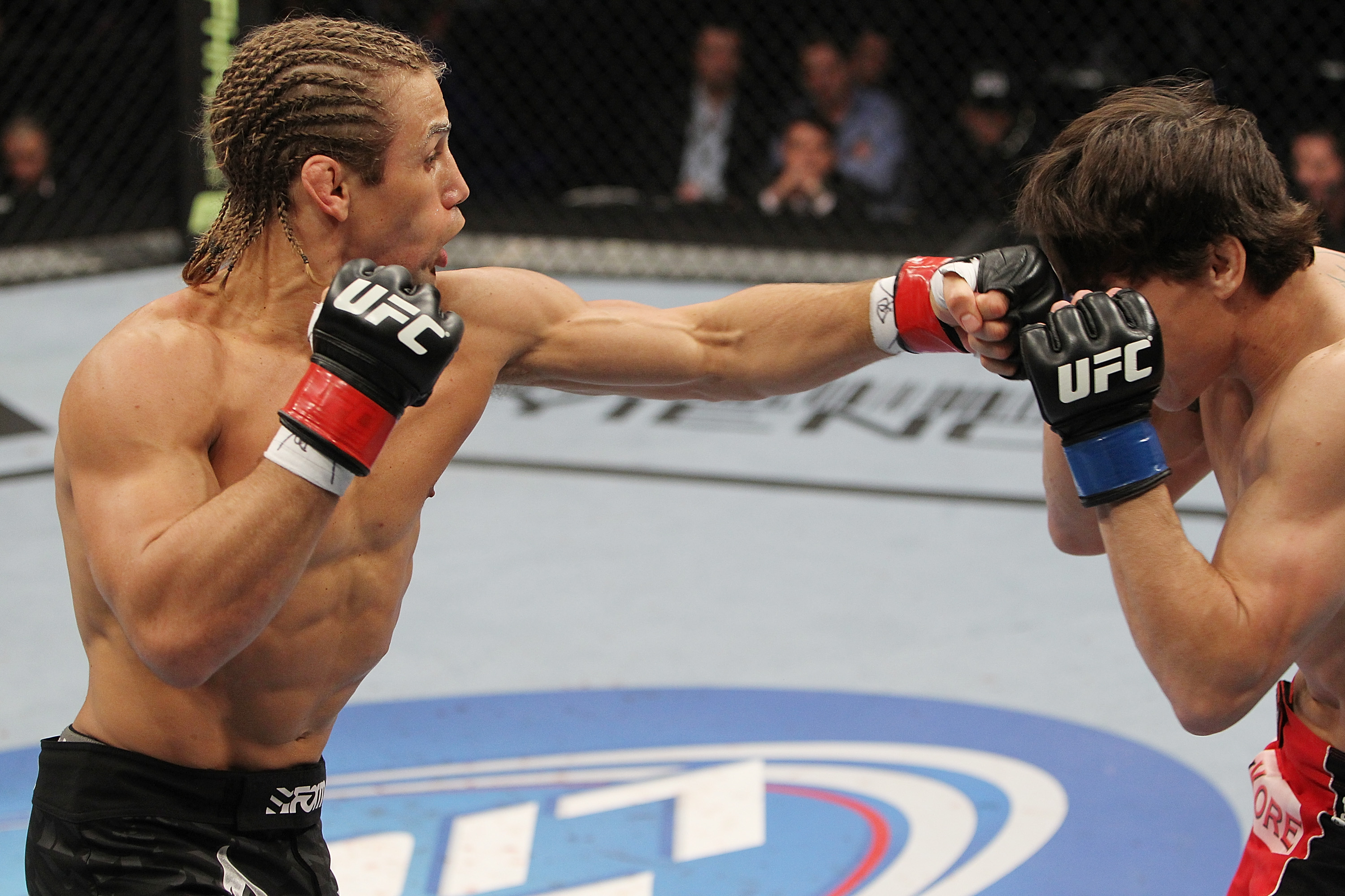 SAN JOSE, CA - NOVEMBER 19: (L-R) Urijah Faber punches Brian Bowles during an UFC Bantamweight bout at the HP Pavillion in San Jose, California on November 19, 2011 in San Jose, California.  (Photo by Josh Hedges/Zuffa LLC/Zuffa LLC via Getty Images)