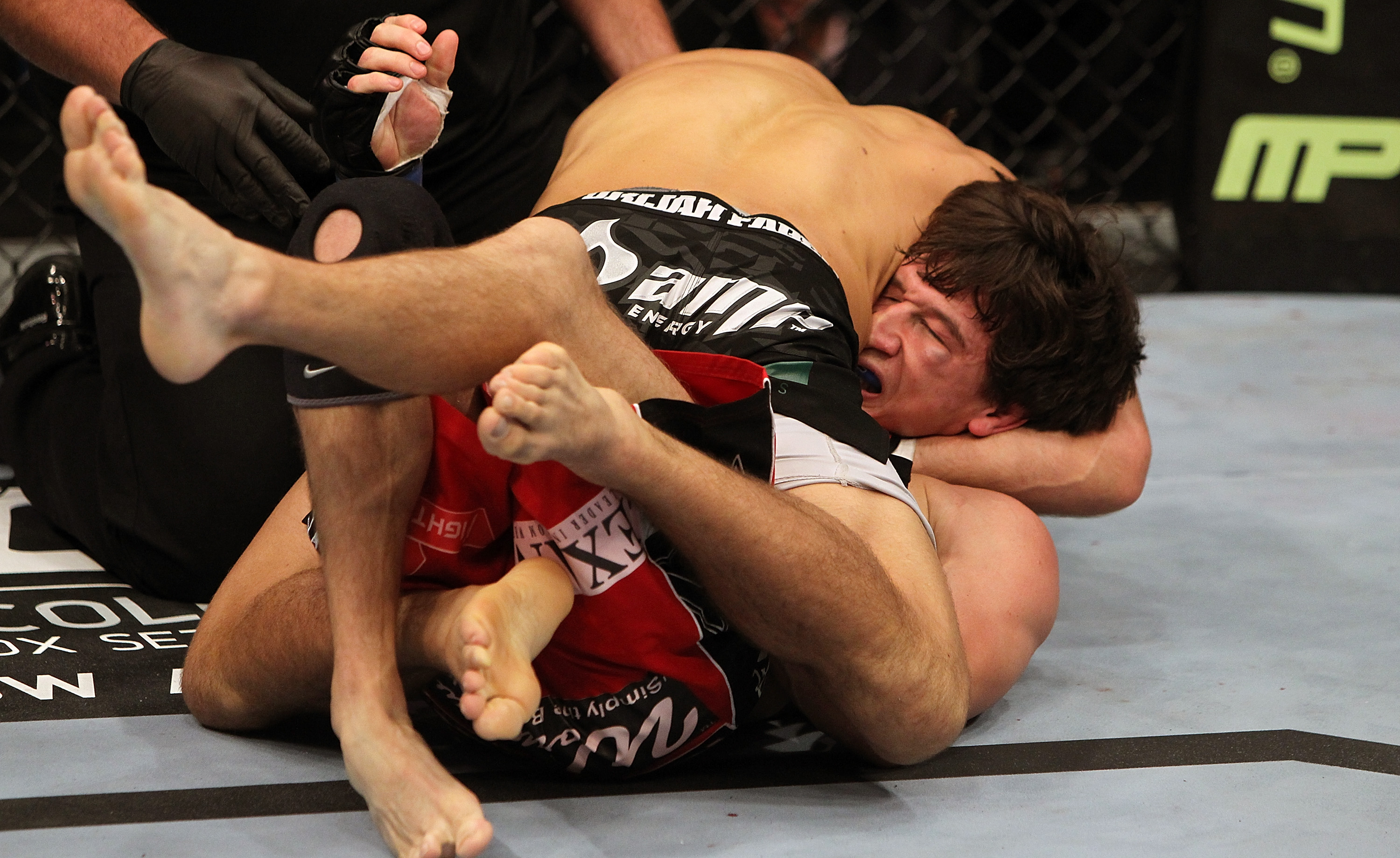 SAN JOSE, CA - NOVEMBER 19: Urijah Faber (top) holds Brian Bowles (bottom) in a head lock during an UFC Bantamweight bout at the HP Pavillion on November 19, 2011 in San Jose, California.  (Photo by Josh Hedges/Zuffa LLC/Zuffa LLC via Getty Images)