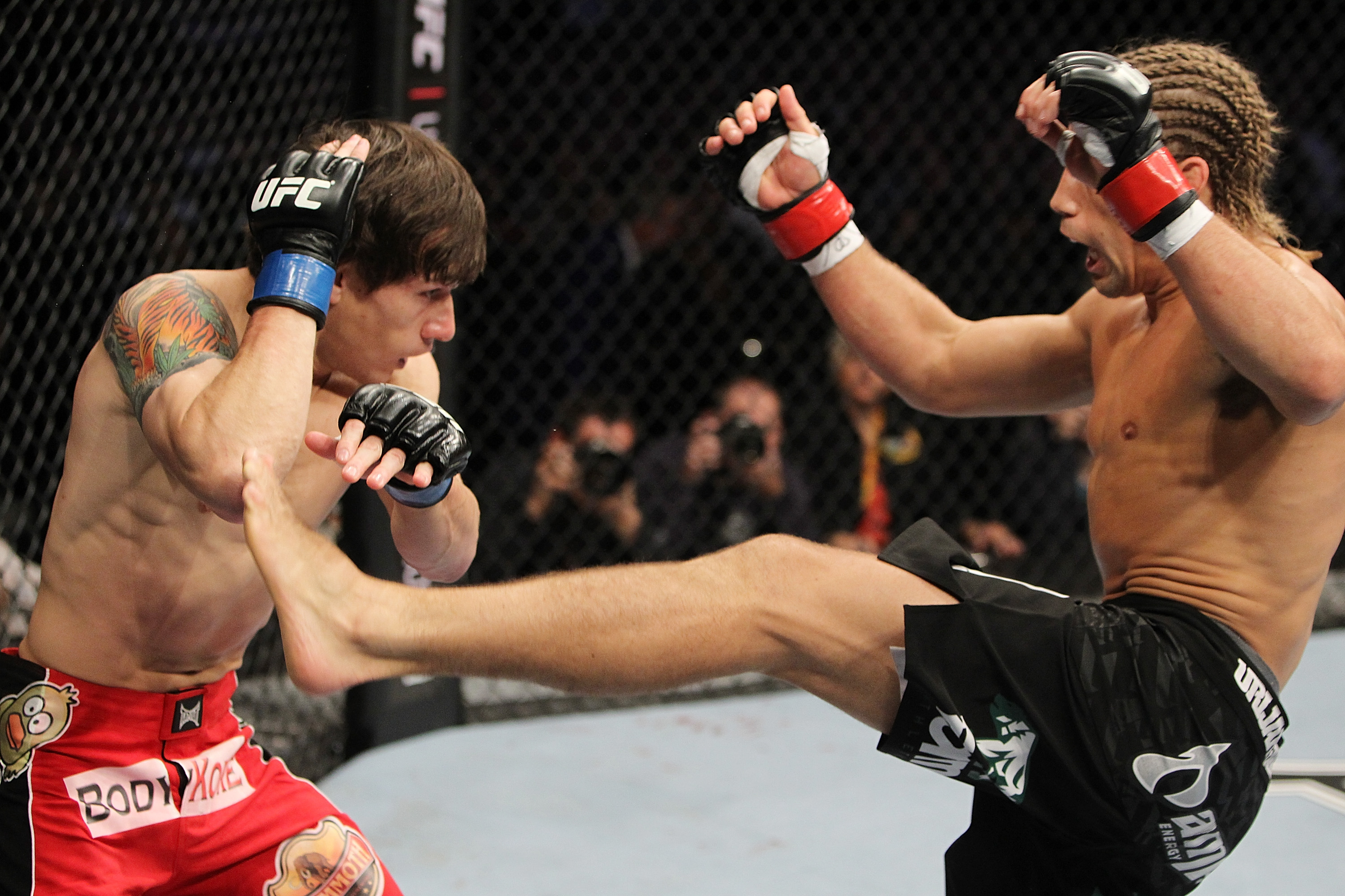 SAN JOSE, CA - NOVEMBER 19: (R-L) Urijah Faber kicks Brian Bowles during an UFC Bantamweight bout at the HP Pavillion on November 19, 2011 in San Jose, California.  (Photo by Josh Hedges/Zuffa LLC/Zuffa LLC via Getty Images)