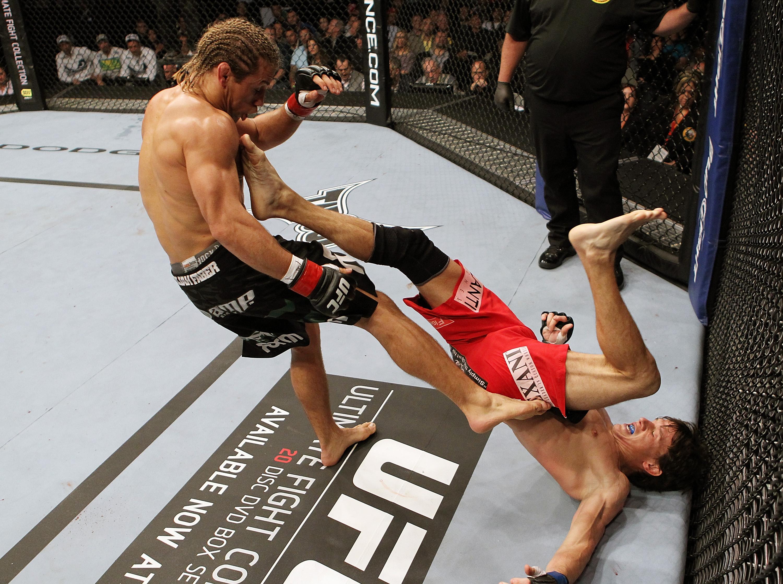 SAN JOSE, CA - NOVEMBER 19: (R-L) Brian Bowles kicks Urijah Faber during an UFC Bantamweight bout at the HP Pavillion on November 19, 2011 in San Jose, California.  (Photo by Josh Hedges/Zuffa LLC/Zuffa LLC via Getty Images)