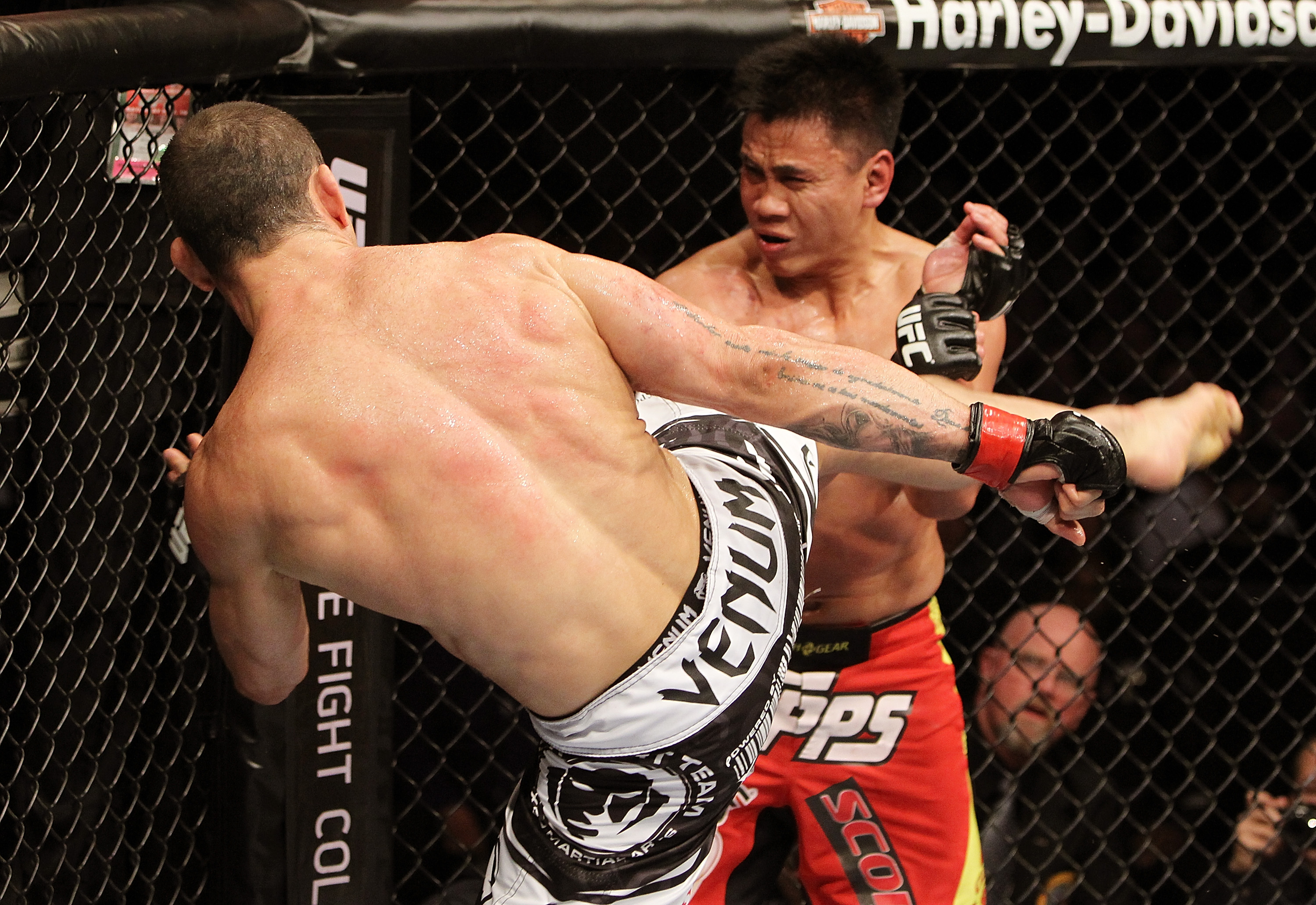 SAN JOSE, CA - NOVEMBER 19: (L-R) Wanderlei Silva kicks Cung Le during an UFC Middleweight bout at the HP Pavillion on November 19, 2011 in San Jose, California.  (Photo by Josh Hedges/Zuffa LLC/Zuffa LLC via Getty Images)